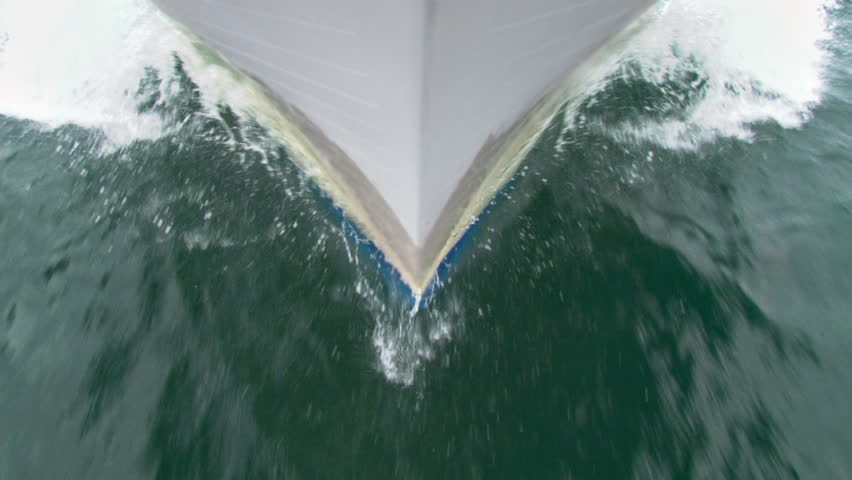 Shooting over the bow of a tour boat under way. Camera held by tripod upside