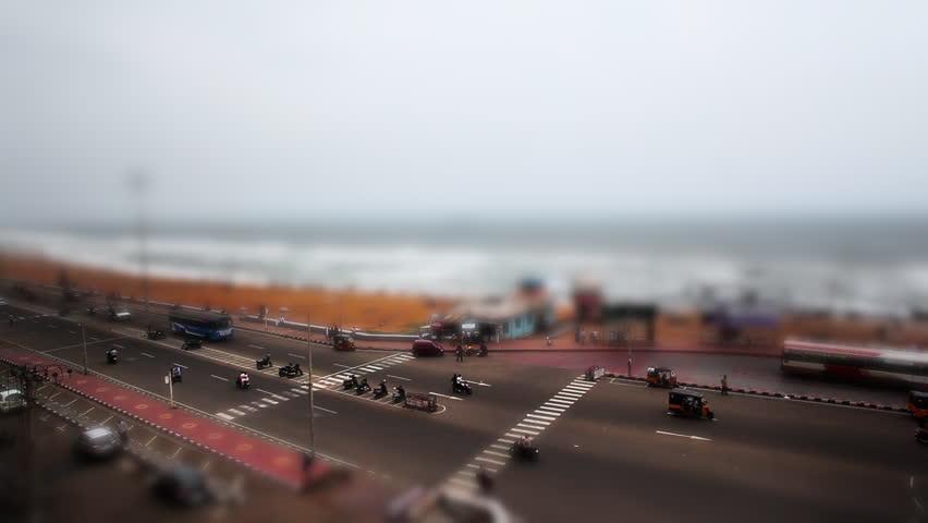Pan shot of traffic moving on the Beach Road at Ramakrishna Beach, Visakhapatnam, Andhra Pradesh, India - HD stock video clip