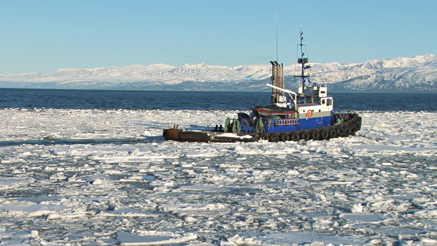Tugboat Redoubt Leaving Icy Harbor - HD stock video clip