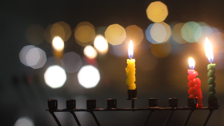Beautiful candles and Hanukkah menorah with defocused background, dolly shot.