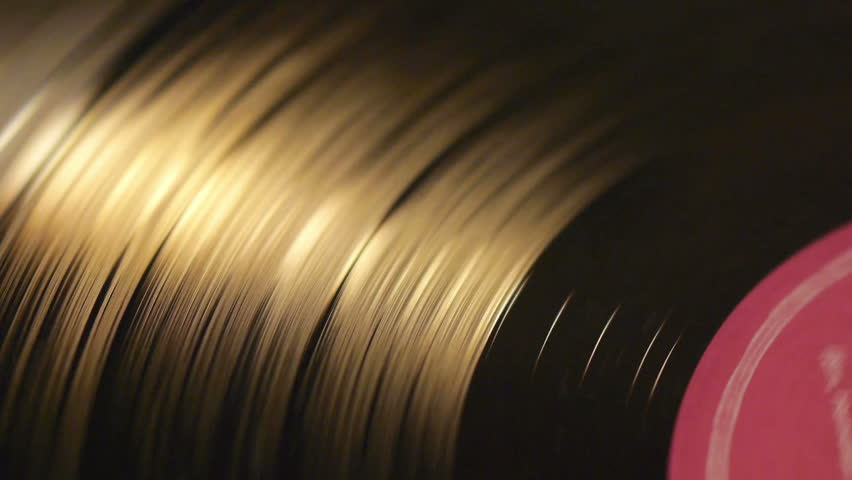 Vinyl record on turntable, viewed from above.