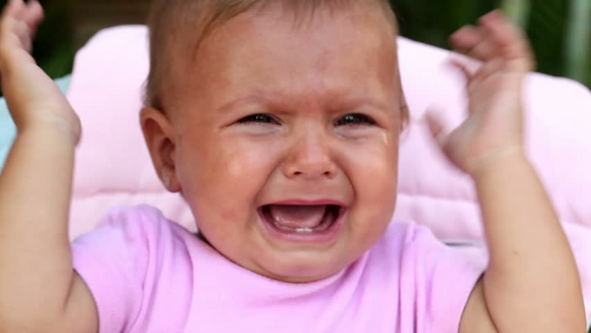 Face of unhappy baby girl crying