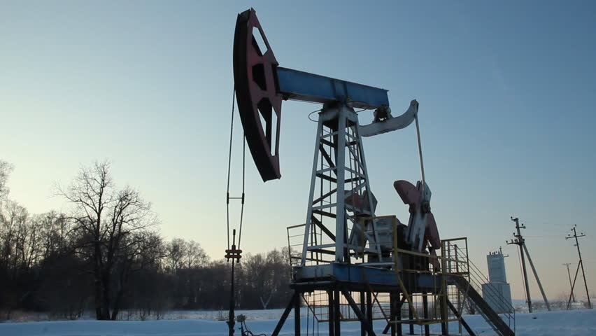 Oil production in the winter. oil pumps  - HD stock footage clip