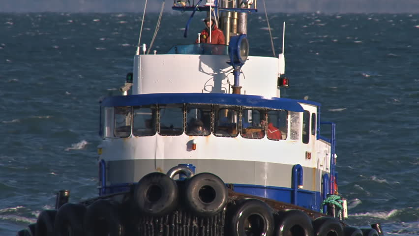 HOMER, AK - CIRCA 2011: Tugboat Redoubt Pilothouse Crew close and reverse zoom - HD stock footage clip