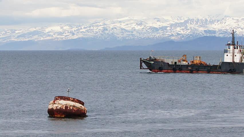HOMER, AK - CIRCA 2011: Large industrial landing craft leaving Homer Harbor
