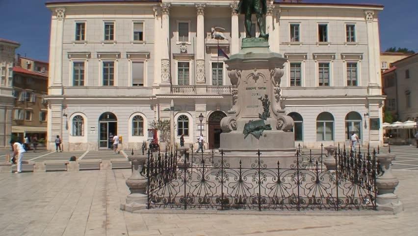 PIRAN, SLOVENIA - CIRCA 2011: Giuseppi Tartini statue in front of the civic building in Porec. - HD stock footage clip