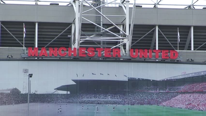 MANCHESTER, UNITED KINGDOM - CIRCA 2011: Zoom out of Manchester United sign on Old Trafford East Stand.