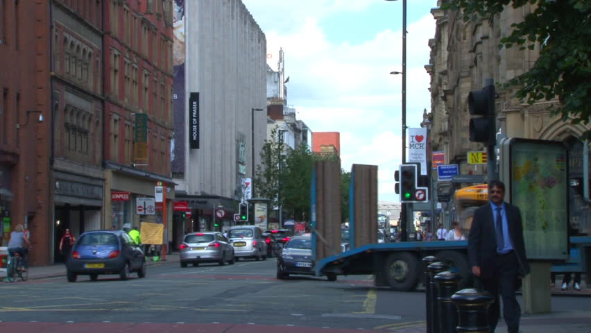 MANCHESTER, ENGLAND - CIRCA 2011: Traffic on Deansgate in Manchester.