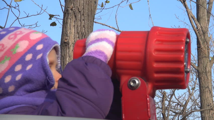 Child Looking in Horizon with a Telescope, Little Girl Playing in Park, Winter - HD stock footage clip