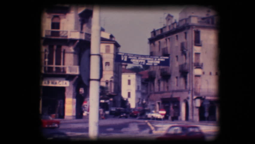 Vintage 8mm. Original footage digitalized. Busy street and statue in Padova, Italy  - HD stock video clip