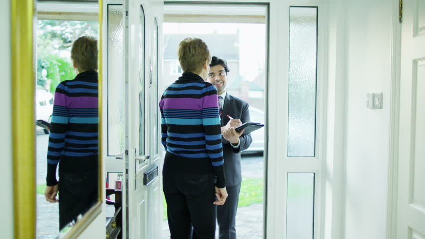 A door to door salesman tries to gain business from a for Door to door salesman