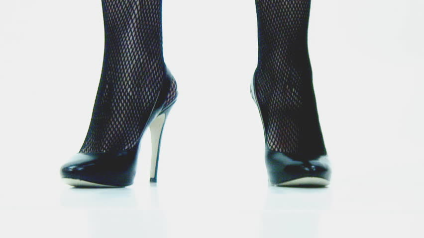 High heels and fishnets - walk in and turn - HD stock video clip