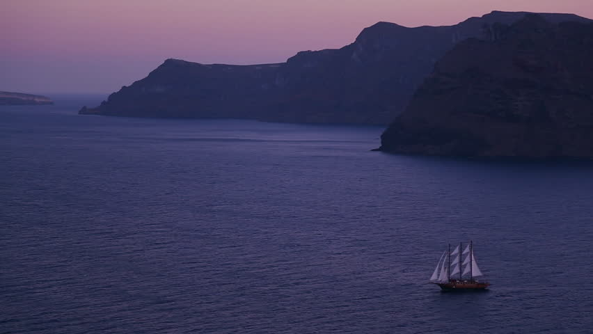 AEGEAN SEA, GREECE 2012 A beautiful sailing ship sails near some islands at night. - HD stock footage clip