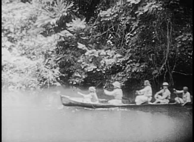 People rowing down river on canoe - SD stock video clip
