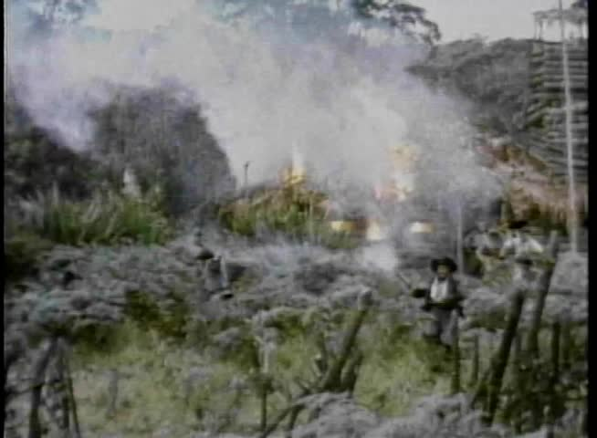 Pirates running away from burning hut - SD stock footage clip