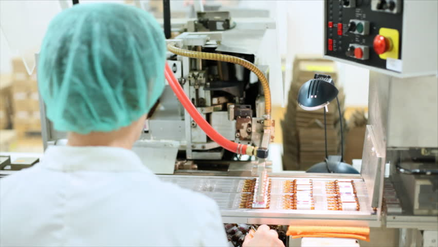 Robotic arm lifting ampules at packaging line in pharmaceutical factory. Sequence.
