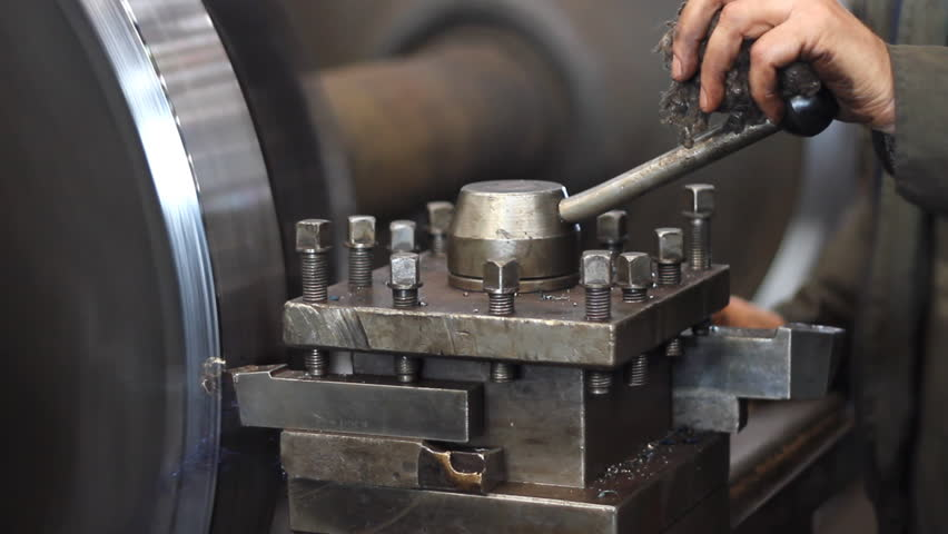 Machining process in the factory, close up, metalworking on a lathe in factory - HD stock video clip