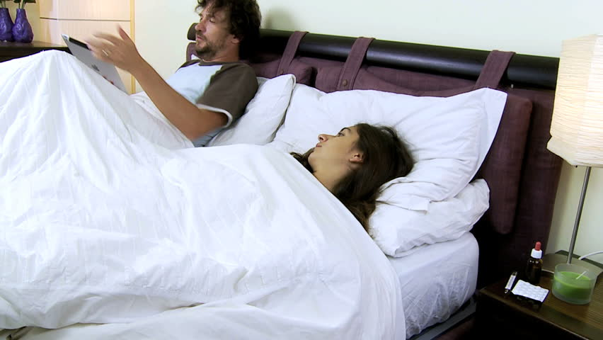 Sick Wife With Fever With Husband In Bed Not Taking Care