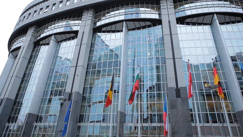 BRUSSELS, BELGIUM - DECEMBER 20: Flags in front of European Parliament Building in Brussels, Belgium on December 20, 2011. - HD stock footage clip