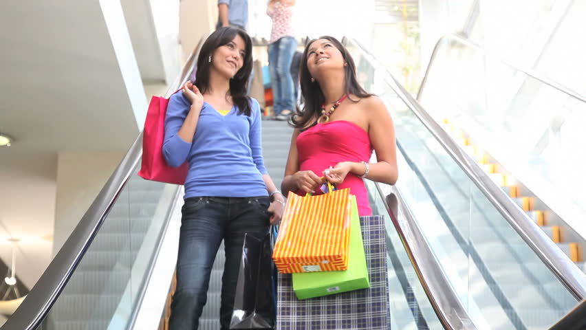 Shopping women on scalators - HD stock footage clip