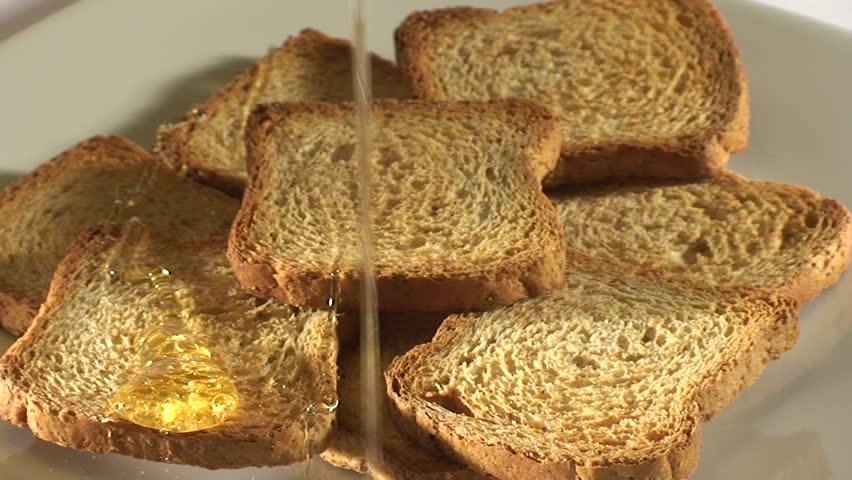 slices of crispy toast-like bread sweeten with honey - HD stock footage clip
