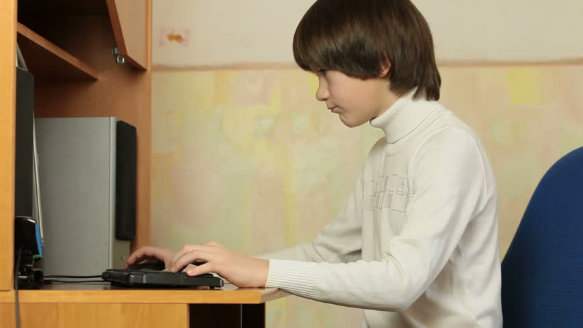 Busy Child Playing Studying Reading Or Surfing The Net