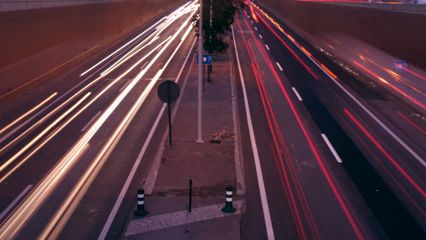 stop motion urban scene of traffic on a major road at dusk in barcelona, spain - HD stock footage clip