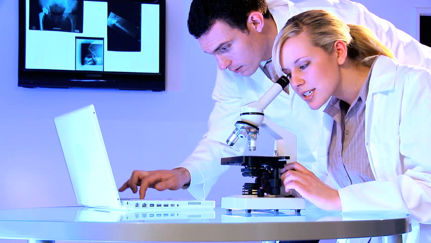 Medical students using laboratory equipment for patient healthcare - HD stock video clip