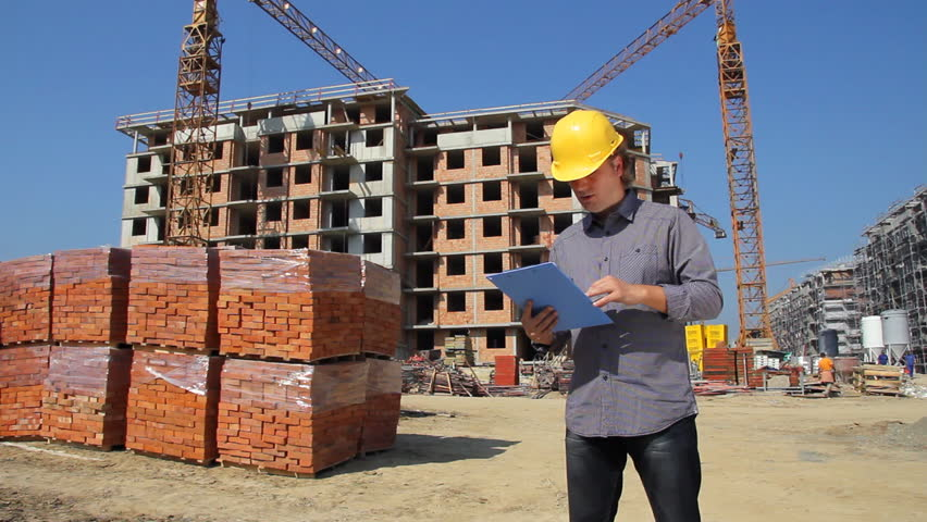 construction engineer planning and controlling building of