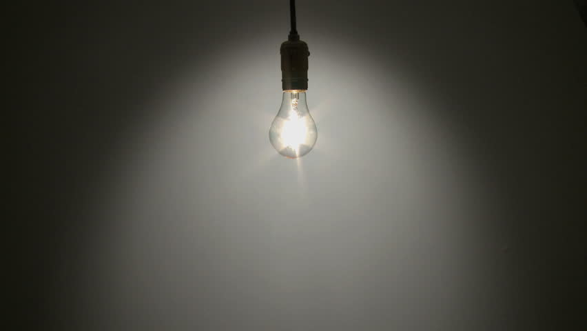 A Light Bulb Illuminates A Dark Room, Much Like An Idea In ...