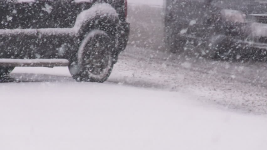 Cars on slippery road in blizzard.  - HD stock footage clip