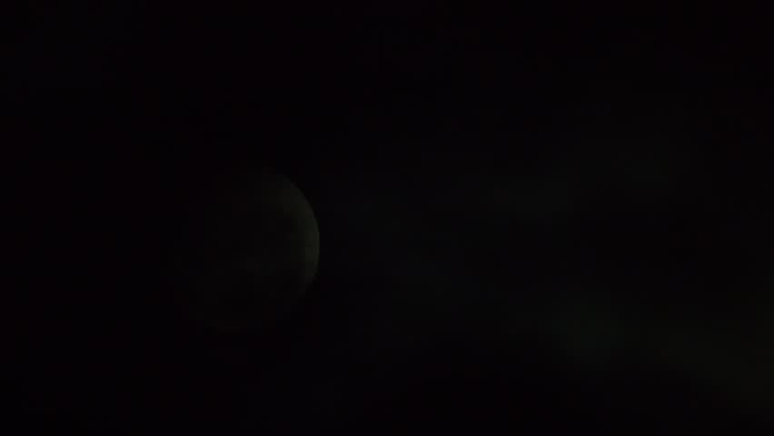 Cloud moving pass bright moon in the middle of the night