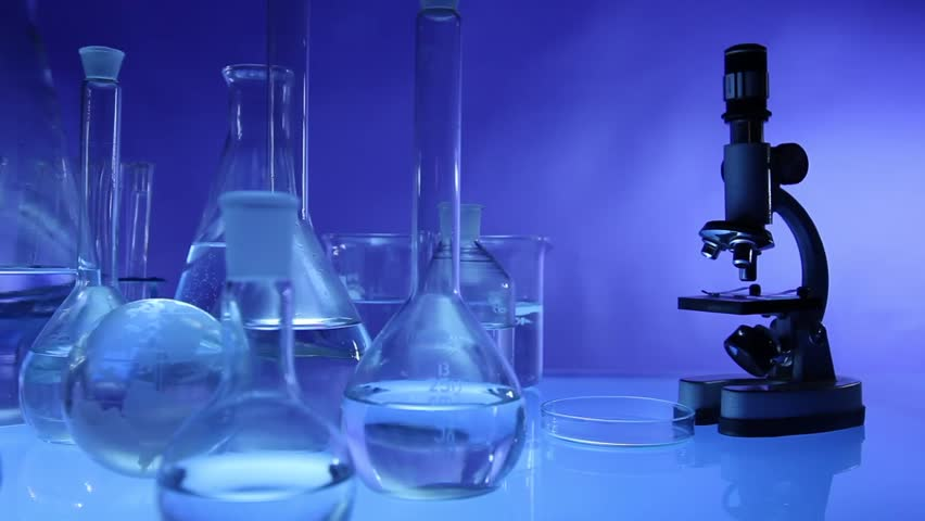 beakers with liquid for experiment in laboratory. dolly shot.  - HD stock footage clip
