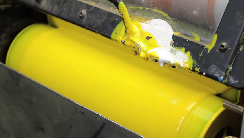 Yellow Paint Running Off a Roller in Printing Press