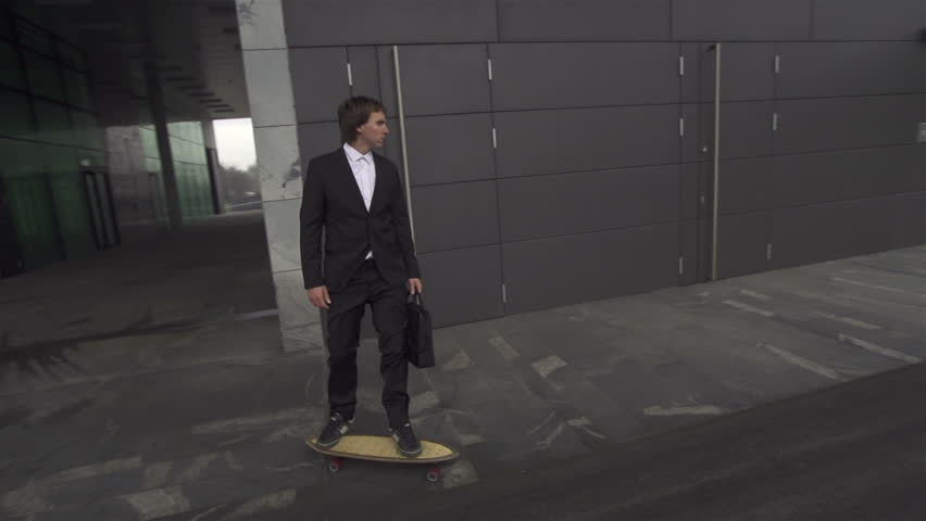 Businessman long boarding to job - HD stock video clip