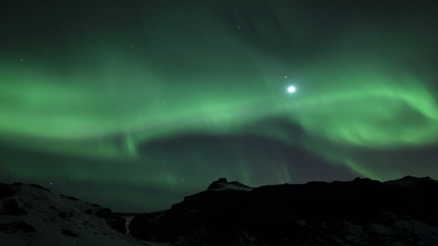 Northern Lights in Lava Field, Reykjavik Iceland. Tourists can be seen walking on the lava field with the aurora overhead - 4K stock footage clip