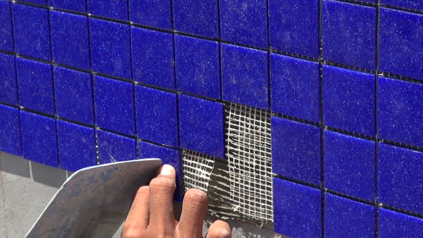 Pool Tile Installation Laborer 39 S Hands Installing Blue Swimming Pool Tile With Trowel Tripod