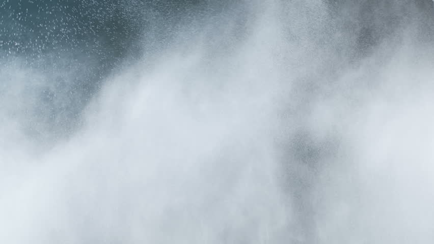 Water fog caused by high-pressure shot over the black background. Can be used as is or as a vfx plate.