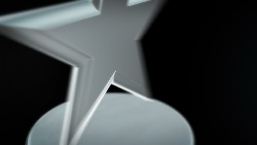 Silver Star Award - Spinning award statue in silver, ideal for any award ceremony. with copy space at the end to put your own text or logo.