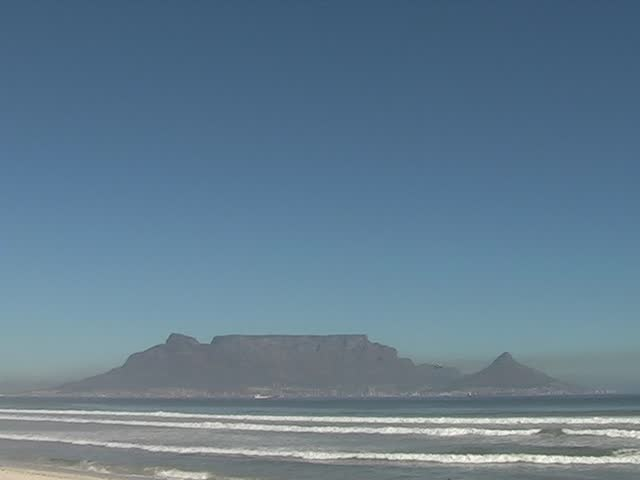 Famous Table Mountain in Cape Town, a landmark in South Africa, on a windless and polluted day - SD stock footage clip