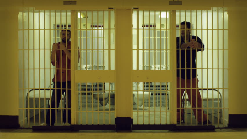 Two cells with bored prisoners doing time.