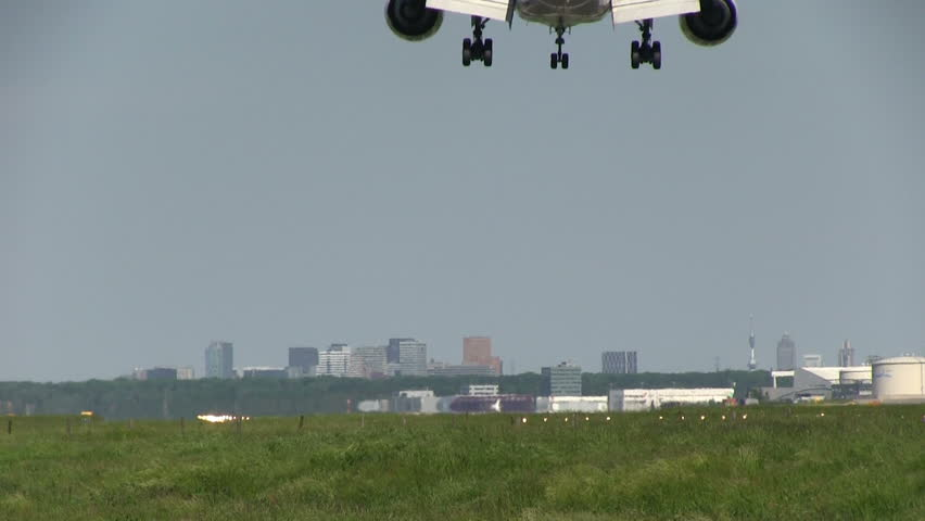 Huge jet landing on sunny day