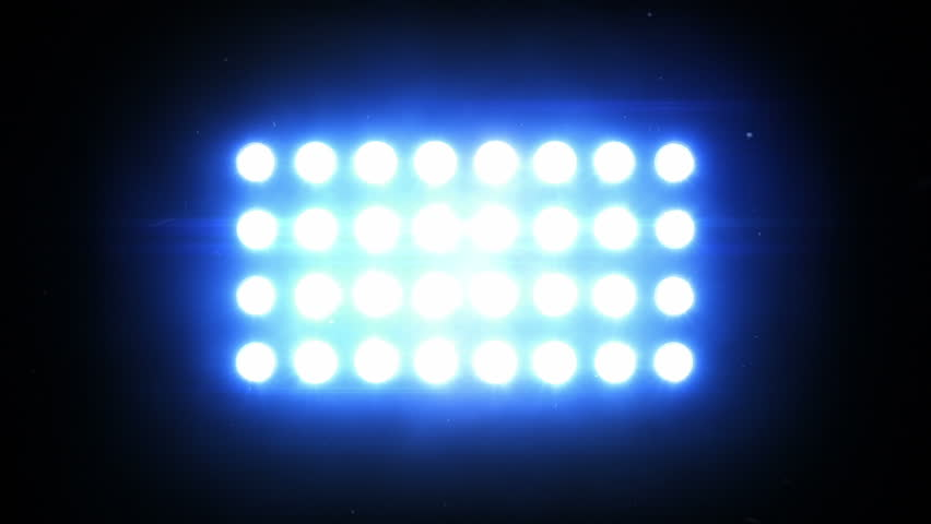 Floodlights. Blue. Bright flood lights flashing. SEE MORE OPTIONS IN MY PORTFOLIO.