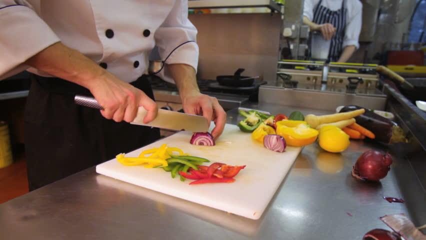 Chef slicing onions - HD stock video clip