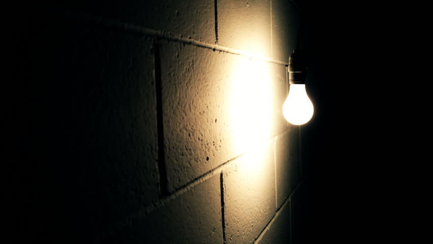 Light Bulb Swaying Against Wall In Dark Room Stock Footage Video 3853673 - Shutterstock