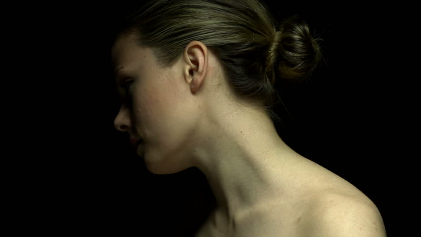 Woman facing away in color. Experimental lighting.