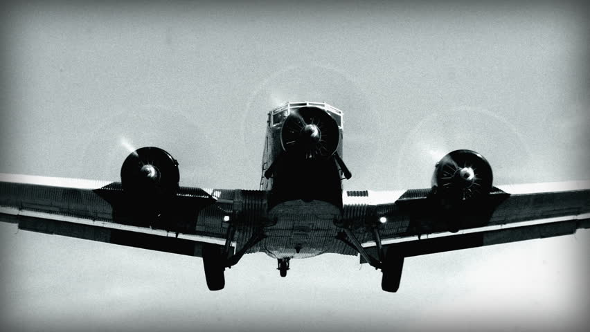 """An 8mm (faked) Black & White shot. Historic airplane, Junkers JU 52 (Nickname """"Tante JU"""") fly over super close. No recognizable people, trademarks or logos! 10922"""