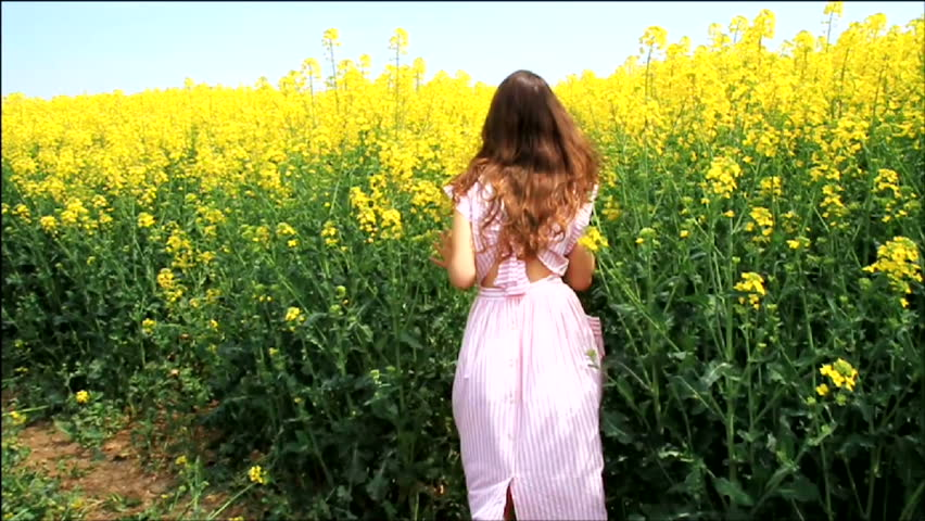 Female Model in Vintage Dress Running through Yellow Field Slow Motion HD