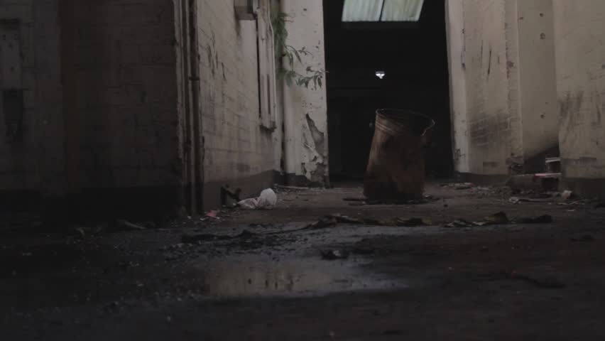 Rusty barrel  in abandoned building (tracking shot)