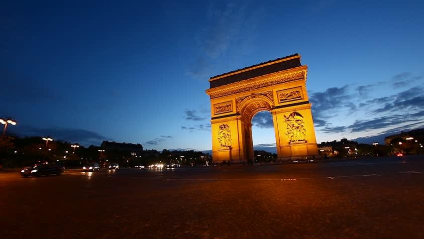 Arch of Triumph at dusk, Paris, France, Arc de Triumphe, Etoile, one of the monuments of Paris, including Eiffel tower, Louvre, Moulin Rouge, Versailles, Seine, Trocadero, Pompidou Center, Notre Dame, | Shutterstock HD Video #3963886